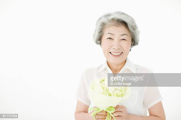 Senior woman holding bouquet