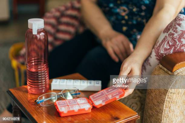Senior Woman Holding Daily Pill Container