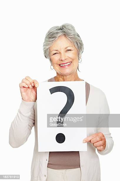 Senior woman holding question mark