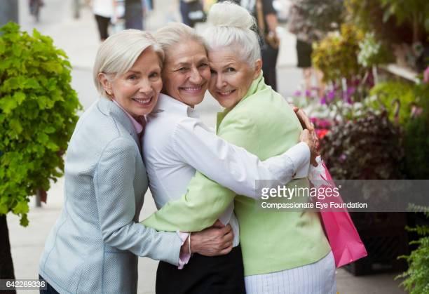 Senior woman hugging on city street