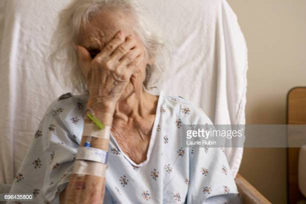 senior woman in a hospital gown - catheter stock photos and pictures