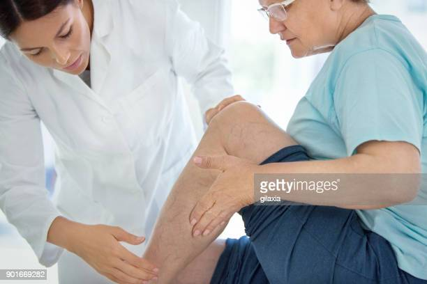 senior woman in a massage treatment. - leg stock pictures, royalty-free photos & images