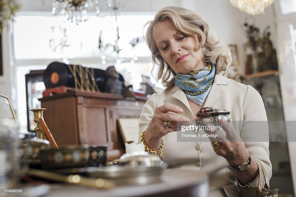 Senior Woman in Antique Shop : Stock Photo