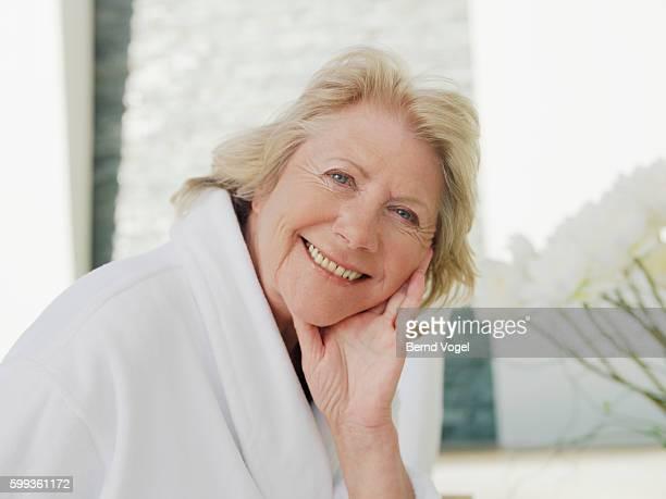 Senior woman in bathrobe