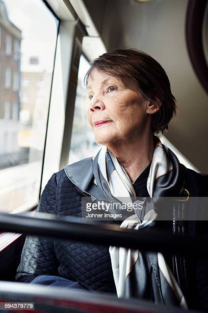 Senior woman in bus