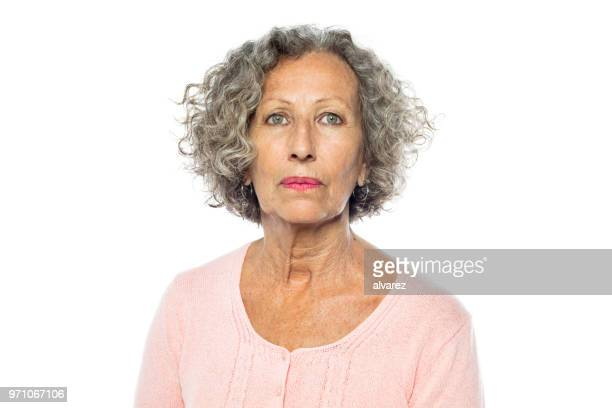 senior woman in casuals looking serious - blank expression stock pictures, royalty-free photos & images