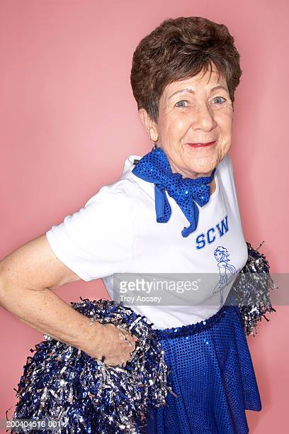 senior woman in cheerleader costume, smiling, portrait, close-up - cheerleader up skirt stock photos and pictures