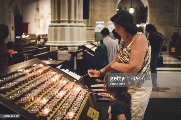 senior woman in church with her granddaughter. - cero foto e immagini stock