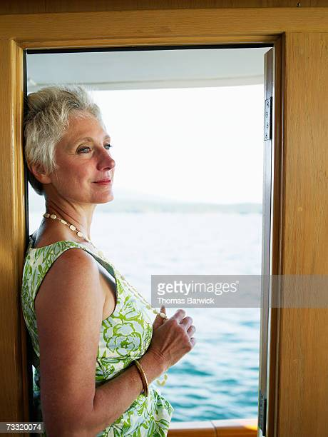 Senior woman in doorway of yacht