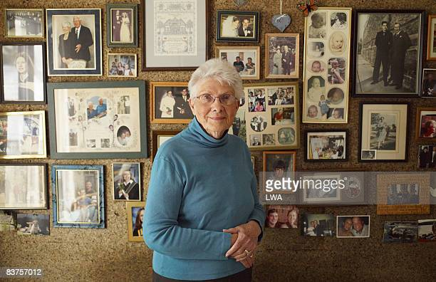 Senior Woman in Front of Family Photos