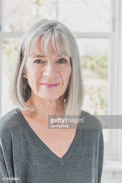 Senior woman in her 60s with grey bobbed hair