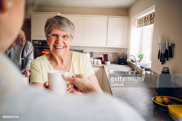senior woman in her kitchen - independence stock pictures, royalty-free photos & images