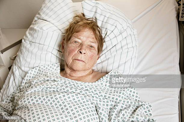senior woman in hospital - old woman in sick bed stock photos and pictures
