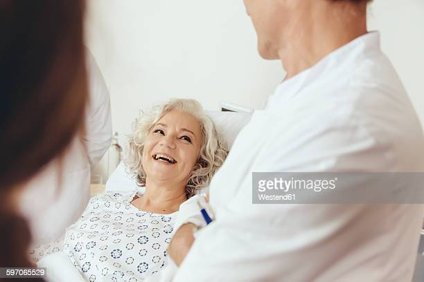 Senior woman in hospital talking to doctor
