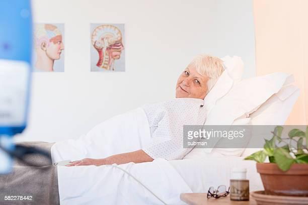 Senior Woman In Hospital Ward