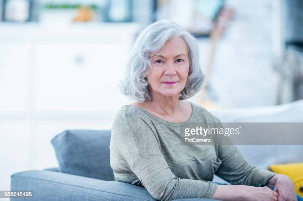 senior woman in house - fatcamera stock pictures, royalty-free photos & images