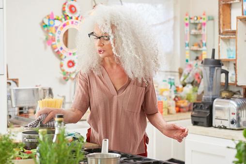senior woman in kitchen cooking - gettyimageskorea