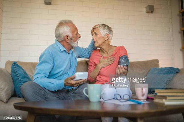 senior woman in pre heart attack state - stroke stock pictures, royalty-free photos & images