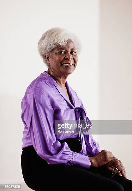 Senior woman in purple blouse, portrait
