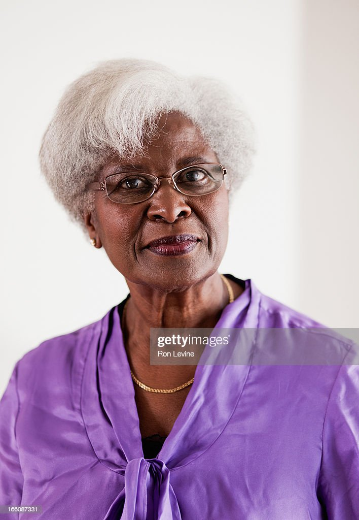 Senior woman in purple blouse, portrait : Stock Photo