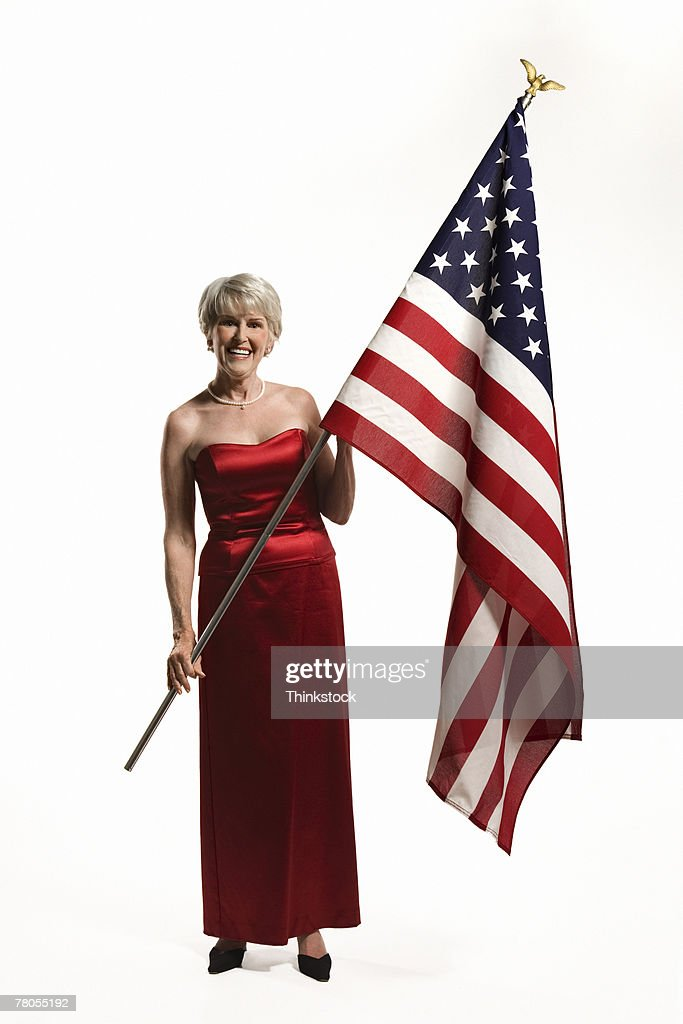 Senior Woman In Red Gown Holding American Flag Stock Photo | Getty ...