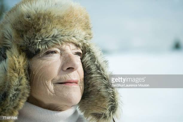 Senior woman in snowy landscape