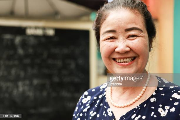senior woman in south east asia - vietnamese ethnicity stock pictures, royalty-free photos & images