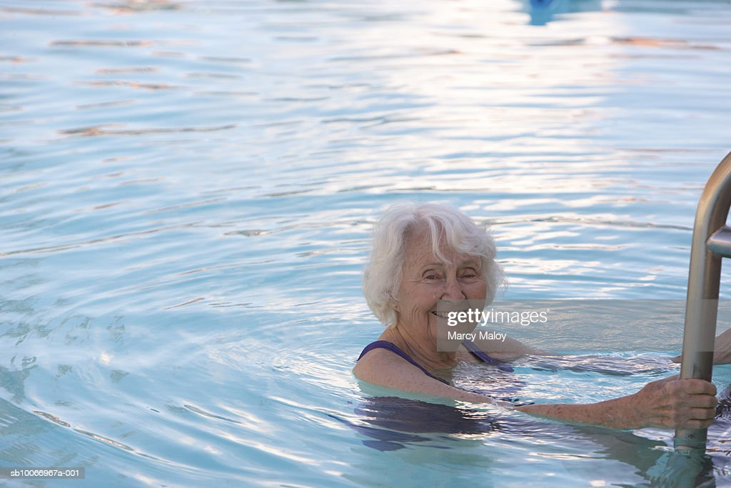 Senior woman in swimming pool portrait stock photo getty images for Female only swimming pool london