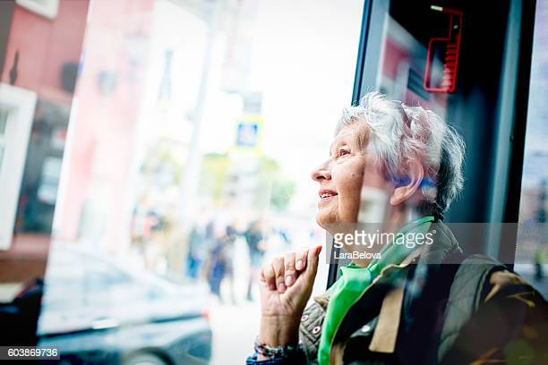 Senior woman in the bus