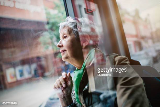 senior woman in the bus - bus stock photos and pictures