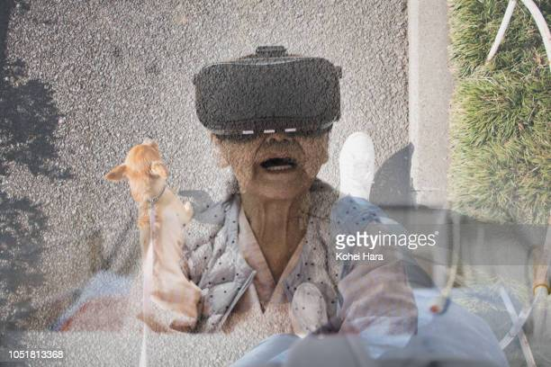 Senior woman in the hospital wearing a Virtual Reality headset