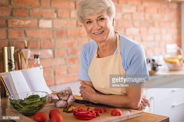 Senior woman in the kitchen. Debica, Poland