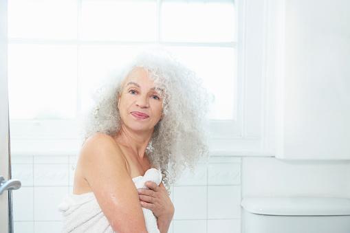 senior woman in towel in bathroom - gettyimageskorea