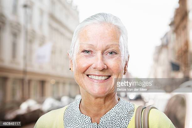 senior woman in urban street.