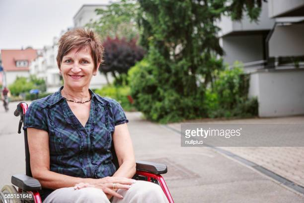 Senior woman in wheelchair, enjoying a day in the city