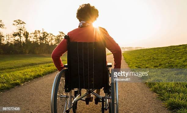 Senior woman in wheelchair in the nature