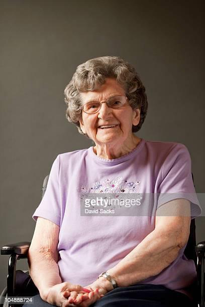 Senior woman in wheelchair, smiling