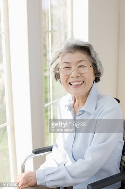 Senior woman in wheelchair smiling