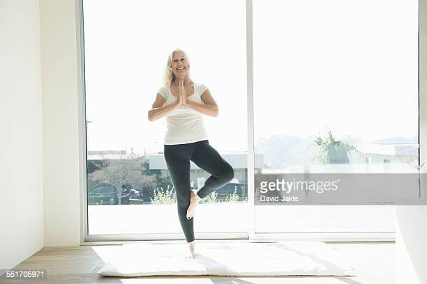 Senior woman in yoga pose