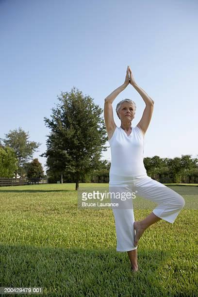 Senior woman in yoga position