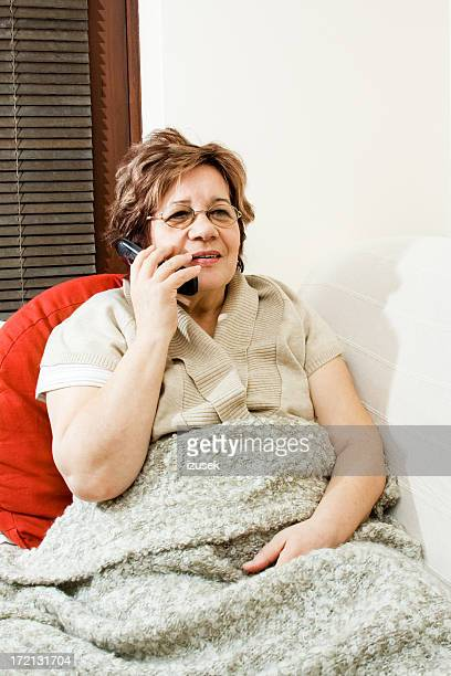 Senior woman is chating with family