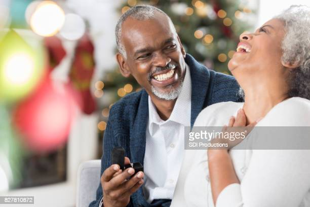 senior woman is excited to receive jewelry at christmastime - african american christmas images stock pictures, royalty-free photos & images