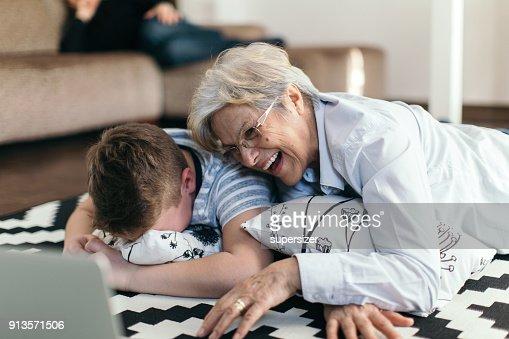 Senior woman is knitting sweather