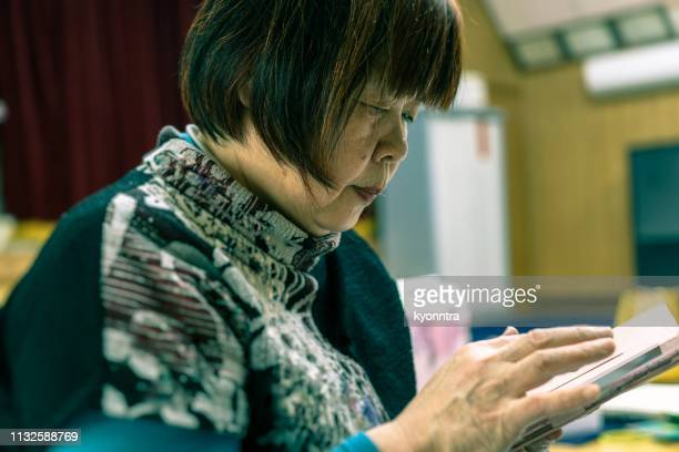 A senior woman is using smart phone