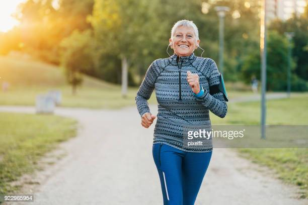 Senior woman jogging in the park