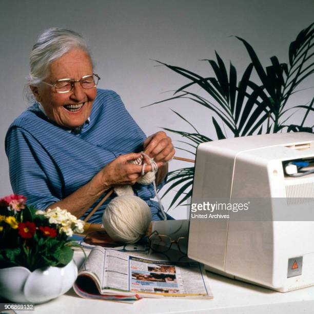 Senior woman knitting, 1980s.