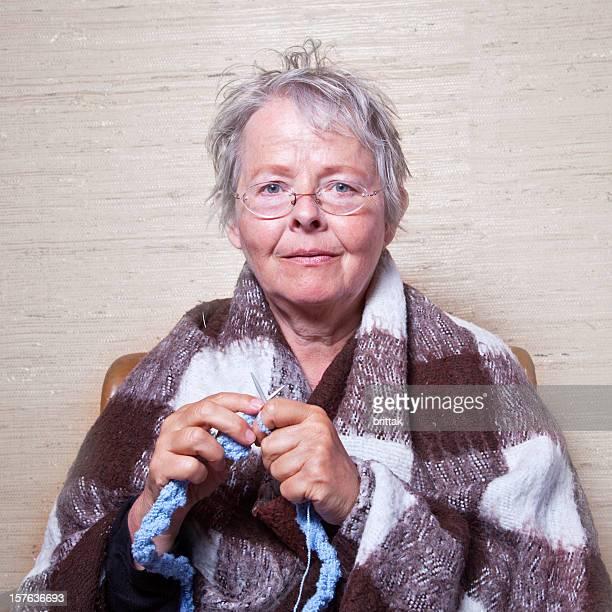 Senior woman knitting.