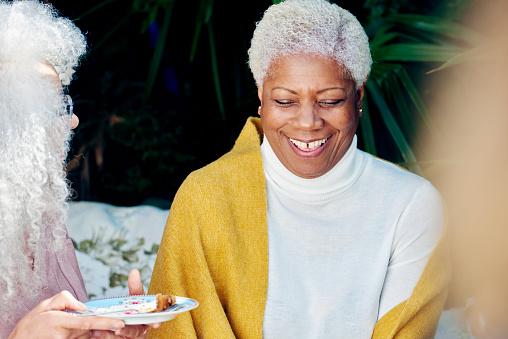 senior woman laughing in garden - gettyimageskorea