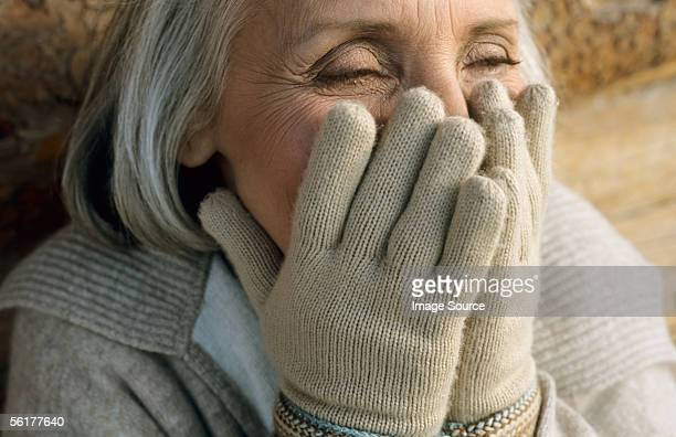 senior woman laughing - beige glove stock photos and pictures