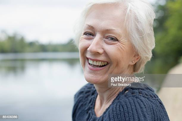 senior woman laughing - 60 64 years stock pictures, royalty-free photos & images